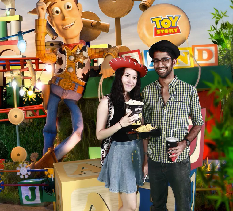 A couple inside the Toy Story Land.