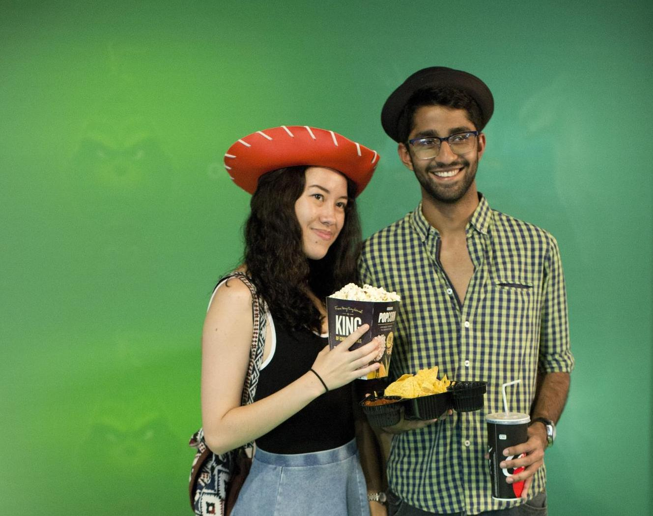 A couple posing for a Toy Story photo.