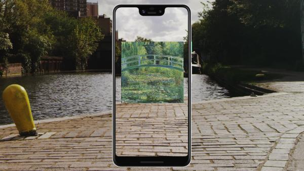 A still from the video showing Monet's Waterlilies displayed on a phone in augmented reality over a London canal