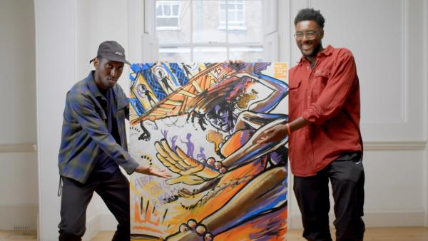 Two men standing either side of a colourful painting
