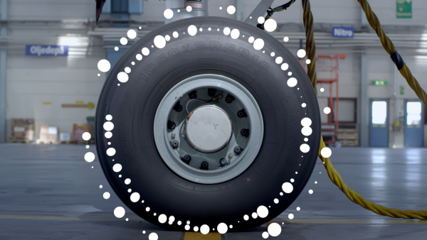 a parked airplane tyre, with graphic annotations